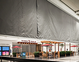 vertical-coiling-deployable-draft-curtain