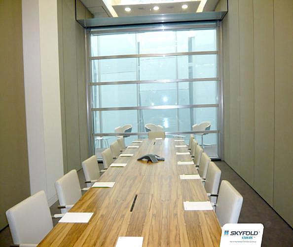 Skyfold vertical folding glass walls interior tech for Folding window wall