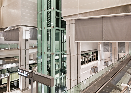 Vertical coiling deployable draft curtain interior tech for Door 00 seatac airport