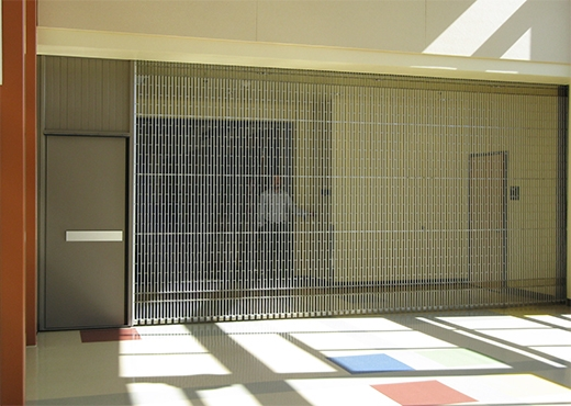 Side Coiling Grilles with Egress & Side Coiling Grilles with Egress - Interior Tech | Seattle | Portland